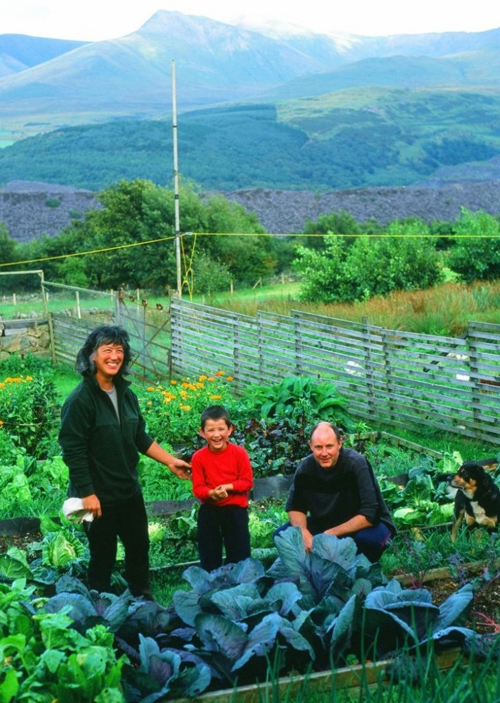 Jenny Wong, Bryan Dickinson and their son Cai in the garden at Ynys Uchaf.