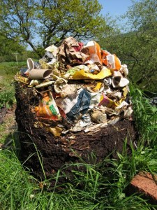 The contents of a recycled plastic compost bin (with the bin removed) showing the different stages of decomposition - fresh material at the top, ready-to-use compost at the bottom.